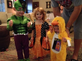 Trying on our Halloween costumes.
